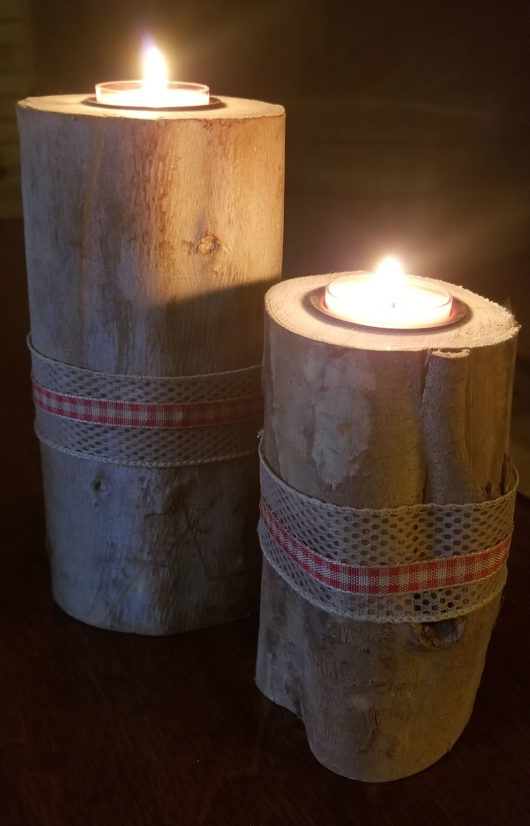 Log Candle Holder Pair Red Ribbon Lit